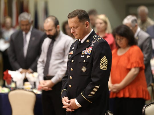 Fort Bliss CSM Robert Cobb prays during the State of the Military Address Tuesday at the Centennial Club.