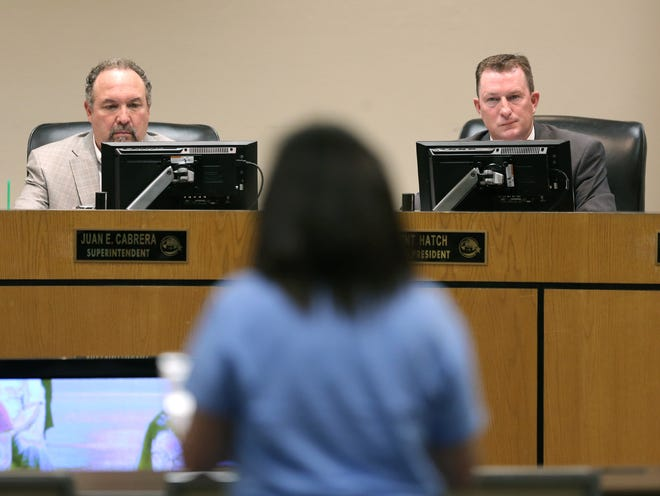 EPISD board President Trent Hatch, right, and Superintendent Juan Cabrera listen to public comment at a meeting.