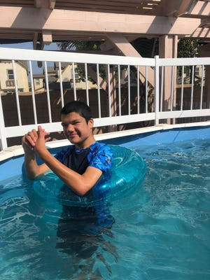 Ryland O'Donnell enjoys the above-ground pool that he received through Make-A-Wish Tri-Counties.
