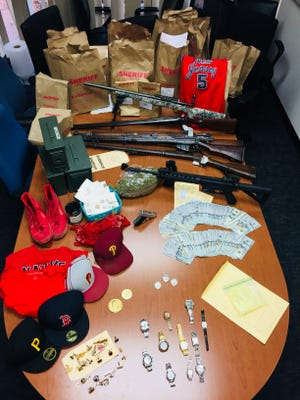 Eight suspects were arrested and multiple guns, drugs and cash confiscated in what Ventura County Sheriff's investigators are calling a residential burglary crew.