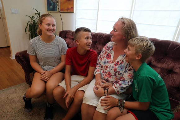 Boukje van den Bosch-Smits with three of her four children, Lente, 14, left, Sjef, 12, and Faas, 10, at their home in Rye on Aug. 21. The family was volunteering at a children's shelter in Indonesia when a 7.0 earthquake struck on August. 5th. After the earthquake, they stayed in Indonesia for another five days helping in the recovery effort.