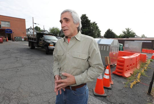 David Kimmel, the interim director for the Rockland Community College Hospitality & Culinary Arts Center in Nyack, stands in the Main Street parking lot the school will use when the center opens next month. Kimmel said a parking structure has been mentioned for the site.