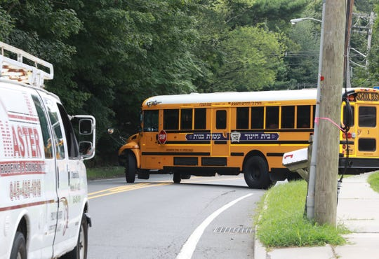 A school bus from the Congregation Bais Chinuch Ateres Bnos school pulls on to Route 306 in Monsey. A judge has ordered the school closed, but it will continue to operate while it appeals the judge's order.