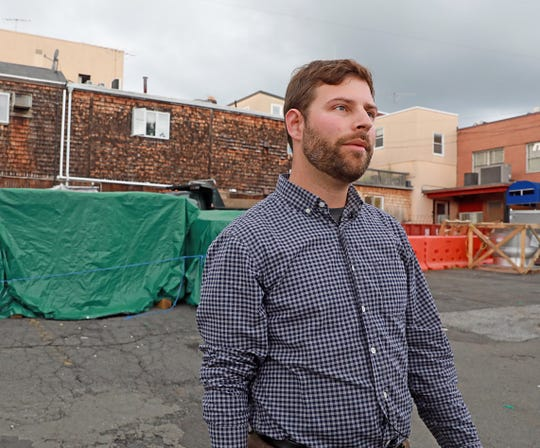 Nyack Village Trustee Elijah Reichlin-Melnick explains how the village board is actively seeking options to replace the loss of more than 70 publicly available spaces in a private lot downtown, on Nyack Aug. 20, 2018.