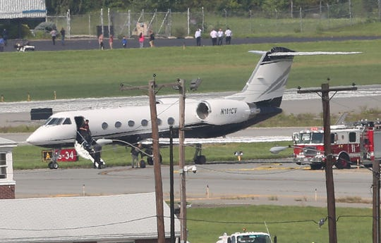 Passengers get off a private jet carrying rapper Post Malone after making an emergency landing at Stewart Airport in Newburgh Aug 21, 2018.