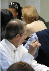 Guy Parisi, left, at the Westchester County Board of Elections in White Plains in 2010.