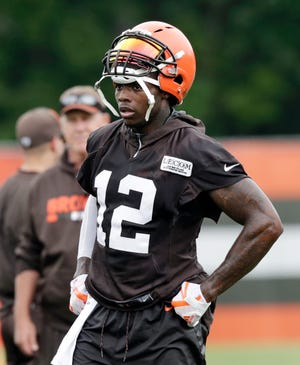In this Tuesday, June 12, 2018, file photo, Cleveland Browns wide receiver Josh Gordon takes a break during practice at the NFL football team's training camp facility, in Berea, Ohio.