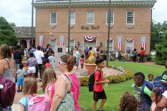 """More than 100 people lined up to receive free backpacks and snow cones Tuesday afternoon at Dover City Hall as part of the Marino Rivera Foundation's """"Back to School Backpack Giveaway"""" for students K-5. The event was from 2-4 p.m. and foundation and city officials expected around 300 backpacks to be given away."""