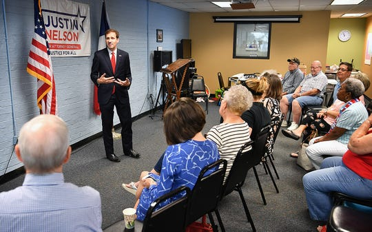 Justin Nelson, candidate for Texas Attorney General, speaks to a group of supporters Tuesday morning at the Wichita County Democratic Headquarters.