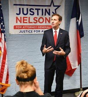 Texas Attorney General candidate Justin Nelson talks about healthcare, teacher salaries and education during a press conference Tuesday morning at the Wichita County Democratic Headquarters.