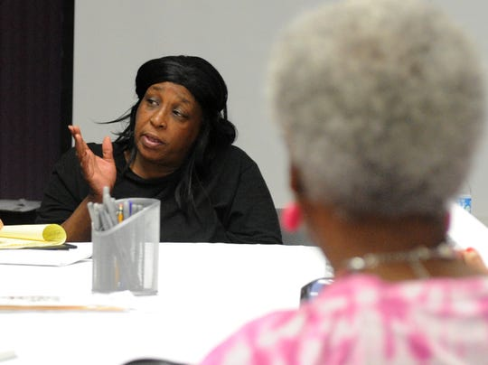 Booker T. Washington alumni association president Gwen Mitchell gives a summary of the issues the association is facing at their meeting Monday, Aug. 20, 2018, in the East Branch YMCA Josie Roberts meeting room. They are meeting at the YMCA after being locked out of their building that is located on the former site of the Booker T. Washington High School.