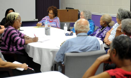 Booker T. Washington alumni association members listen during the meeting Monday, Aug. 20, 2018, in the East Branch YMCA Josie Roberts meeting room. The organization is meeting at the YMCA after being locked out of their building that is located on the former site of the Booker T. Washington High School.