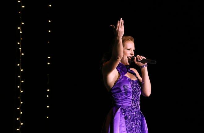 Miss Ohio Matt-Lynn Chrisman sings during a Miss American send-off party in her honor last week in Cambridge.