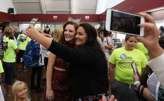 Miss Ohio Matti-Lynn Chrisman poses for a picture with her friend Erin Daniels during a Miss American send-off party in Chrisman's honor last week in Cambridge.