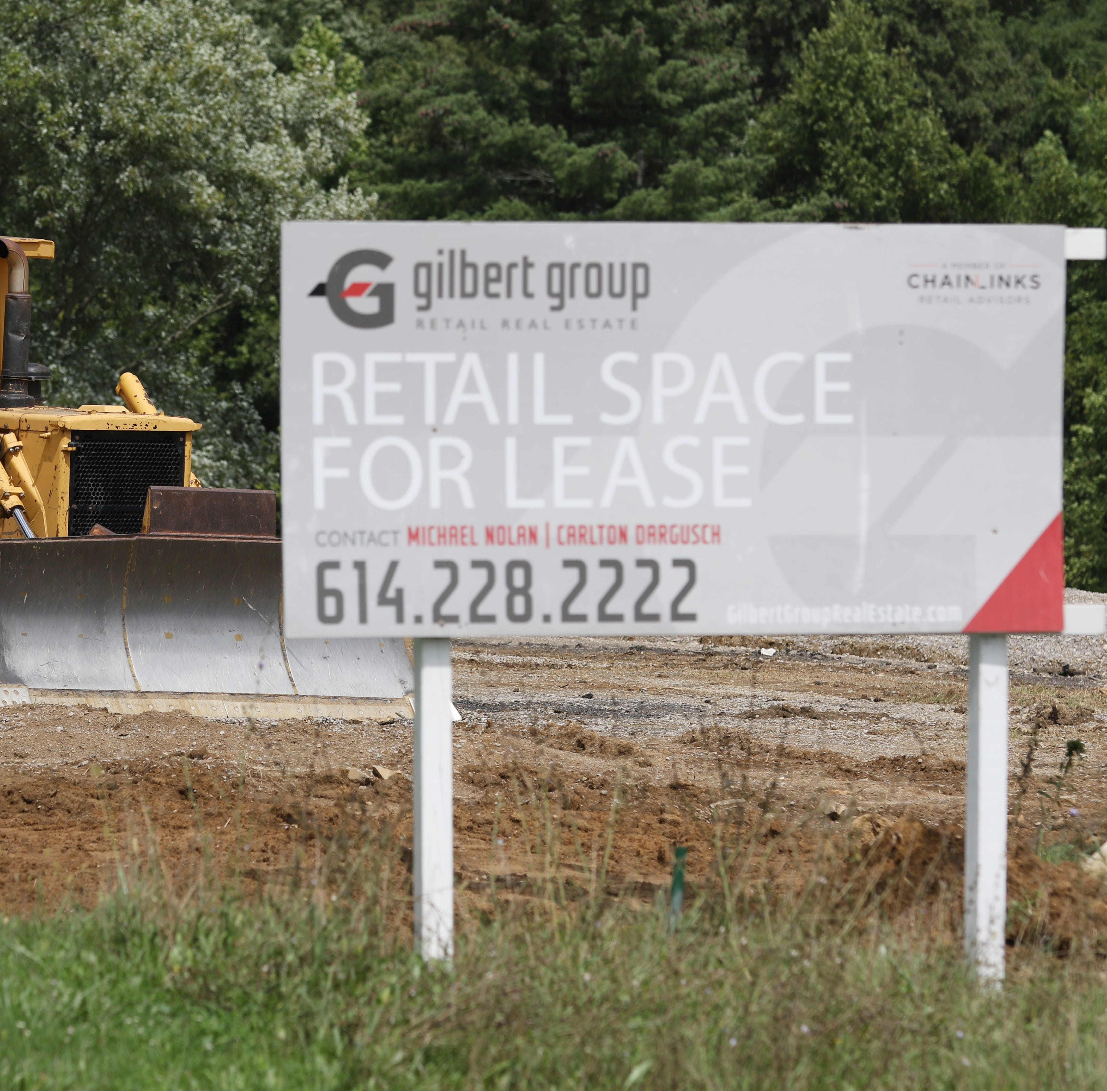 A bulldozer rests near the construction site for planned retail spaces on Frazeysburg Road in Zanesville on Tuesday. Two buildings, holding a total of 6 to 8 tenants are planned. Completion of the project is expected in 2019.