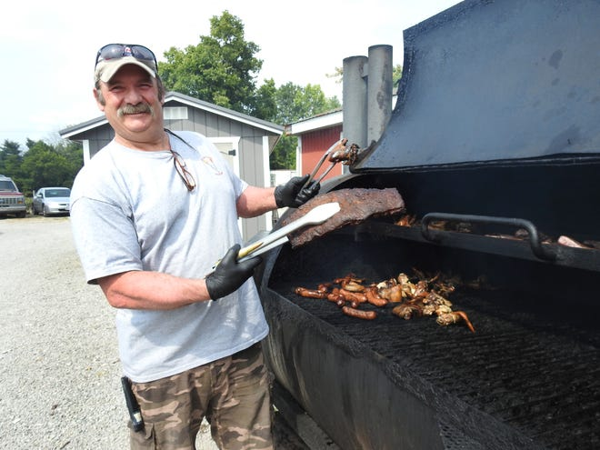The Port Lounge & Smokehouse owner Mark Bernhard shows off the ribs and chicken offered at the Smokehouse. All meat has a house dry rub put on before being smoked for 12-14 hours.