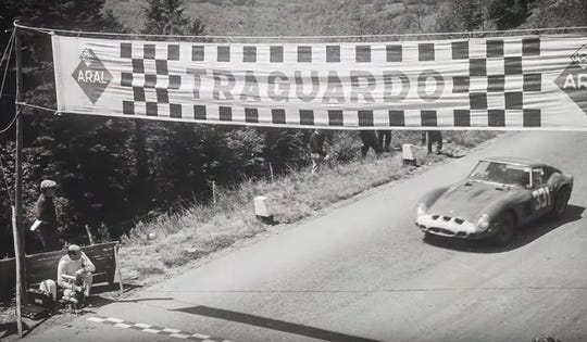 Ferrari GTO serial number 3413 crosses the finish line in a classic Italian road race in the 1960s. The car was dominant in its day. That,  plus its rarity, helps explain today's multimillion-dollar valuation.