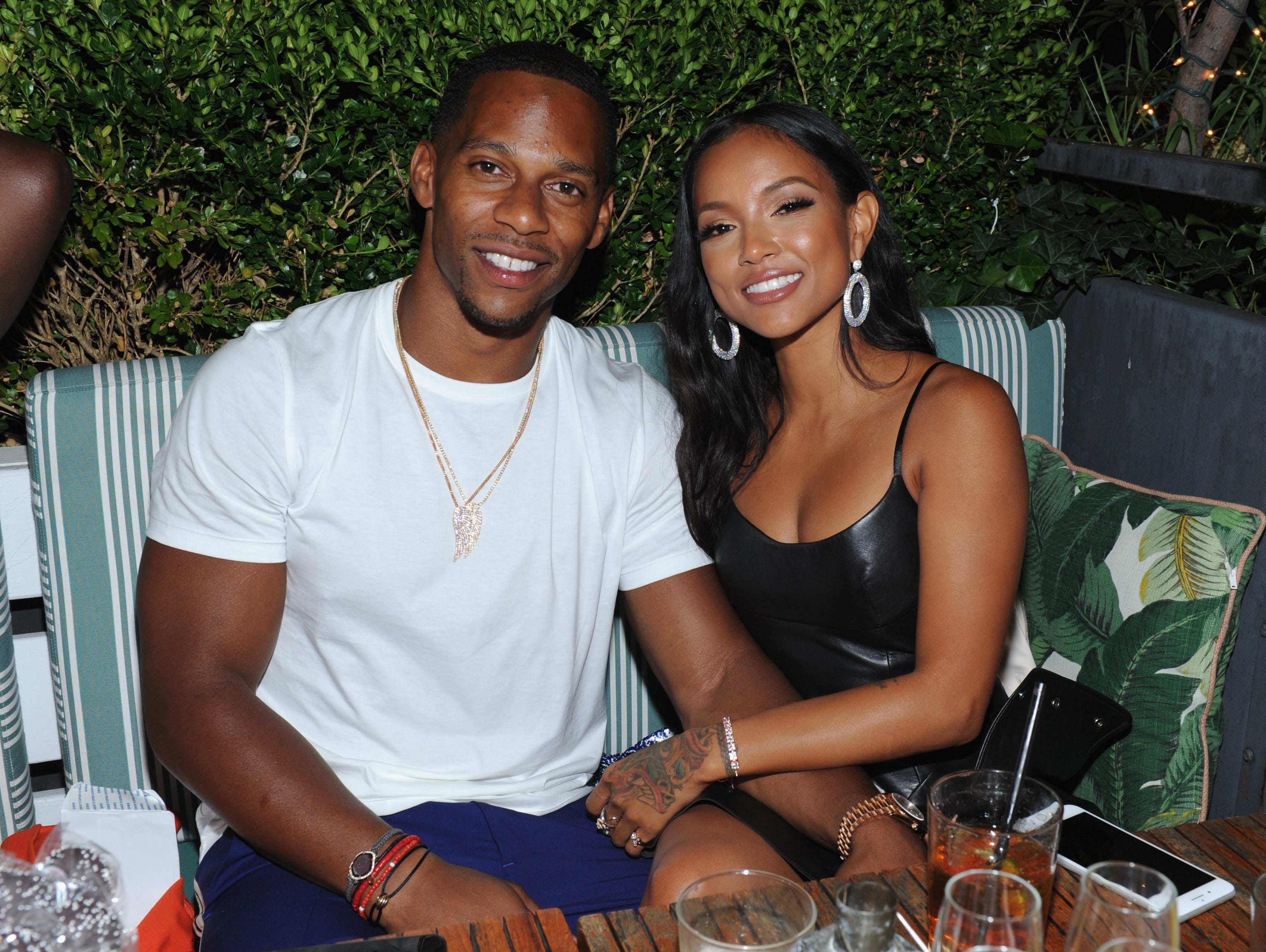 Victor Cruz and Karrueche Tran posed for a photo together at the Republic Records VMA After-Party following the award ceremony in New York on Aug. 20, 2018.