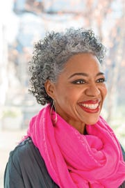 "Melissa Malebranche shows off her majority-gray tresses in a photo from ""Silver Hair: Say Goodbye to the Dye and Let Your Natural Light Shine: A Handbook"" by Lorraine Massey."