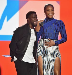 Kevin Hart and Tiffany Haddish speak onstage at the VMAs.