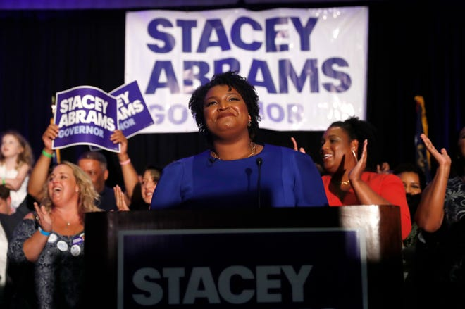 Georgia Democratic gubernatorial candidate Stacey Abrams smiles before speaking to supporters during an election-night watch party on May 22, 2018, in Atlanta. More women than ever before have won primaries for governor, U.S. Senate and House this year.