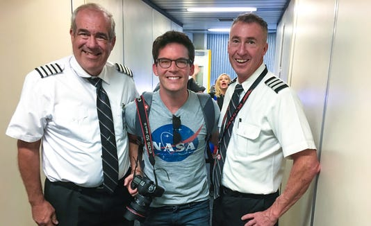 Photographer Jon Carmichael (middle) is pictured with Southwest Airlines Capt. Jeffry Jackson and First Officer Paul Brabham.