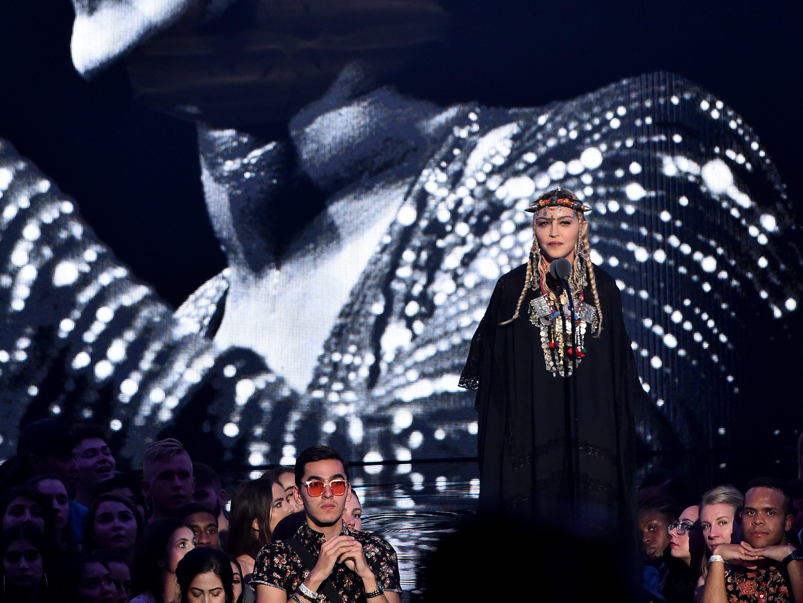 Madonna pays tribute to the late Aretha Franklin onstage before presenting the Video of the Year award.