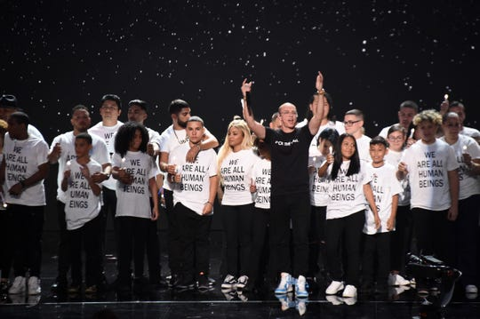 Logic makes a political statement as he performs onstage during the 2018 MTV Video Music Awards.