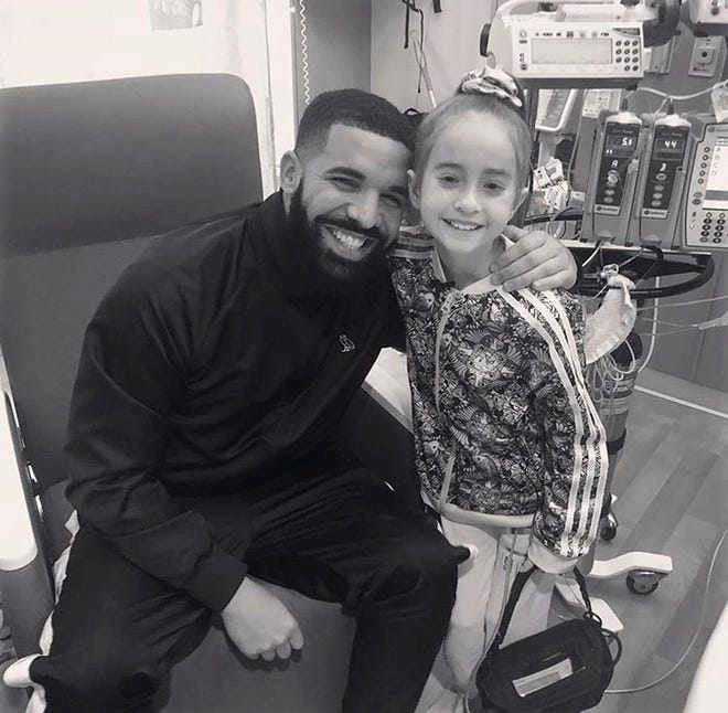 Rapper Drake poses with Sofia Sanchez, 11, at Lurie Children's Hospital in Chicago after he surprised her with a visit.