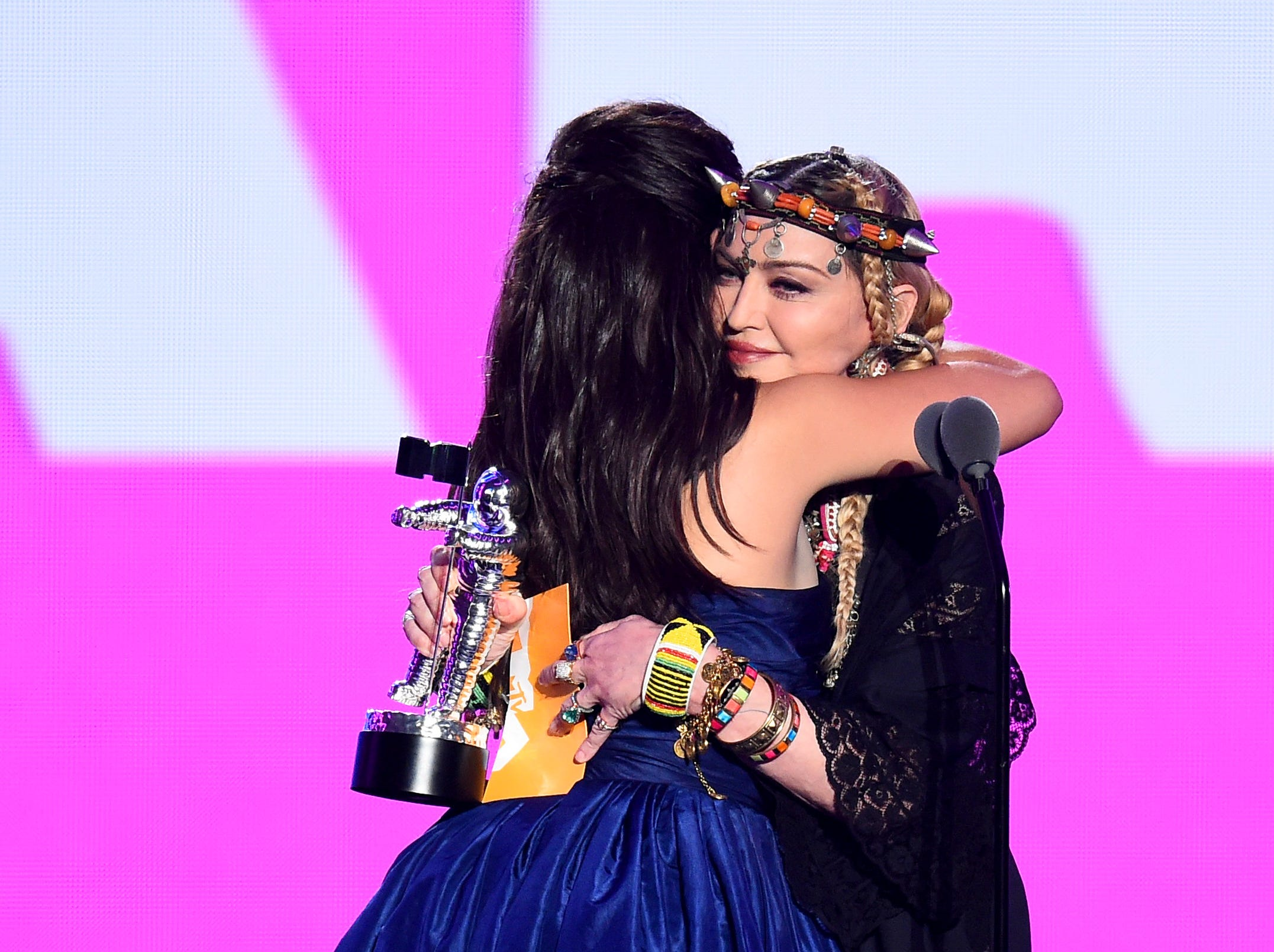 Madonna presents the Video of the Year award to Camila Cabello onstage.