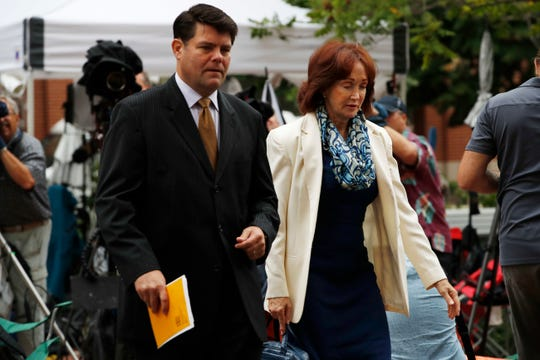 Paul Manafort's wife, Kathleen Manafort, right, walks with Manafort spokesman Jason Maloni to federal court for Day 4 of jury deliberations in the trial of the former Trump campaign chairman, in Alexandria, Virginia, Aug. 21, 2018.