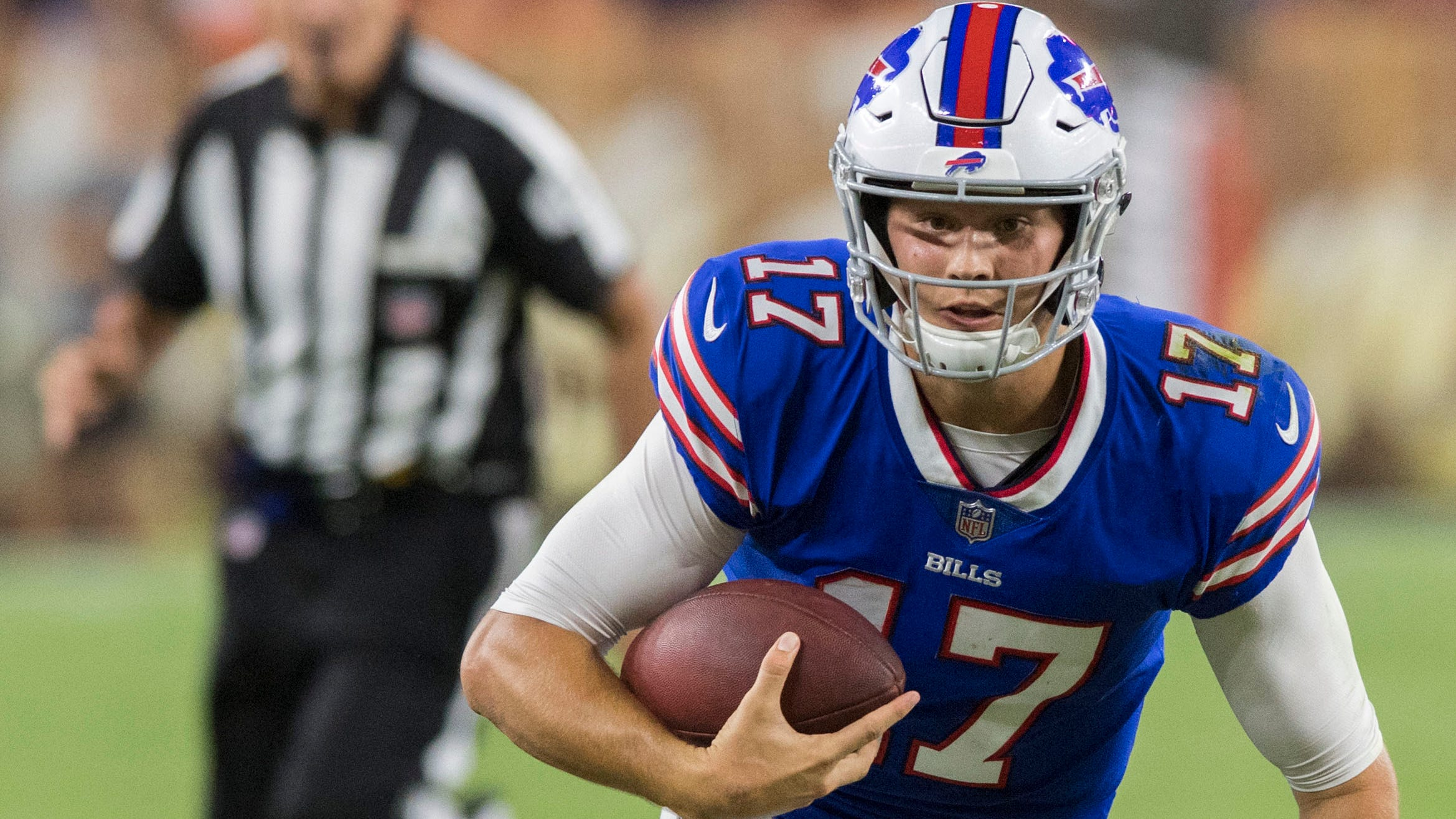 Josh Allen runs with the ball against the Browns.