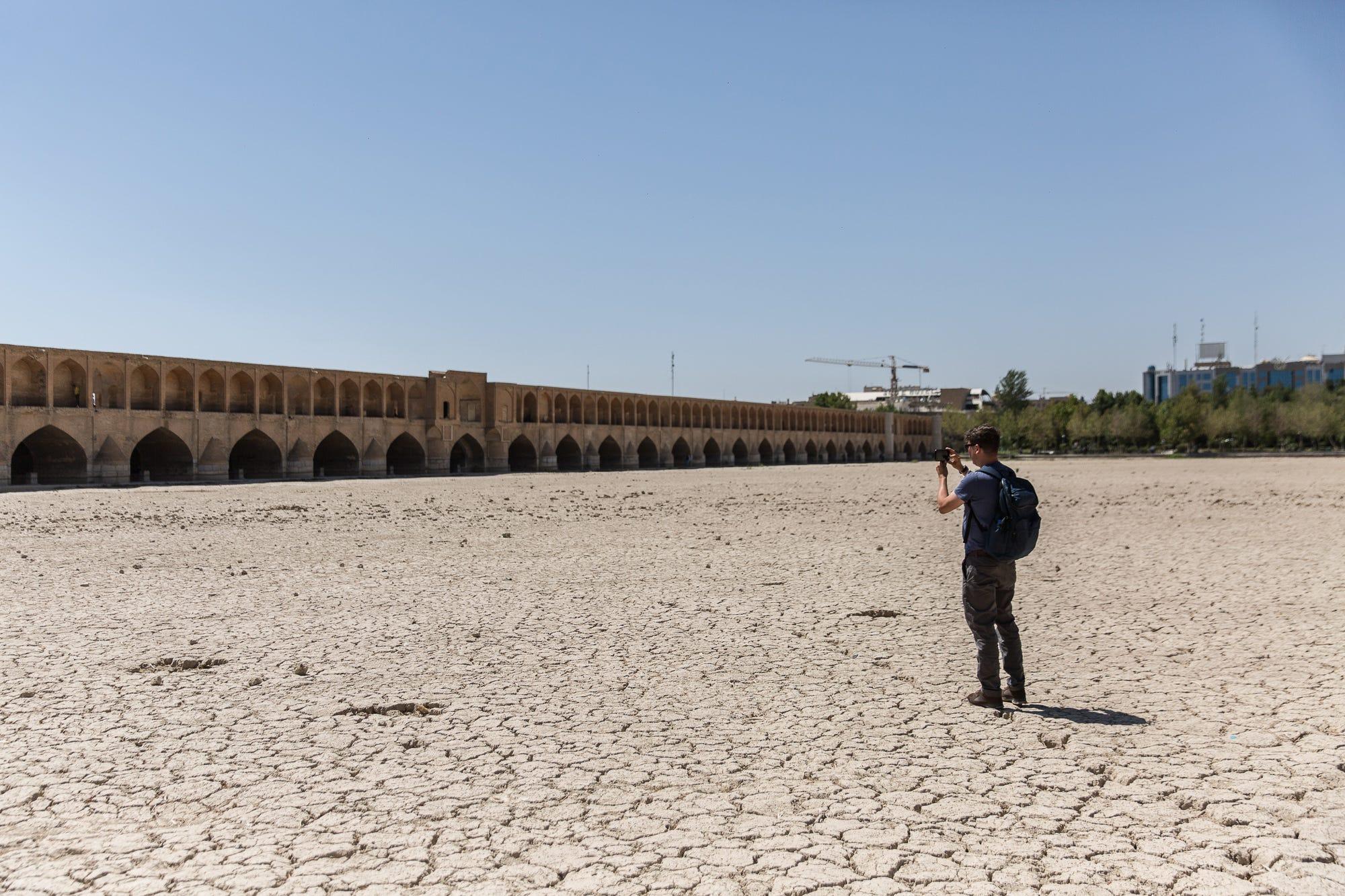 Kim Hjelmgaard takes a photo of Isfahan's Allahverdi Khan Bridge, also known as Siosepol.