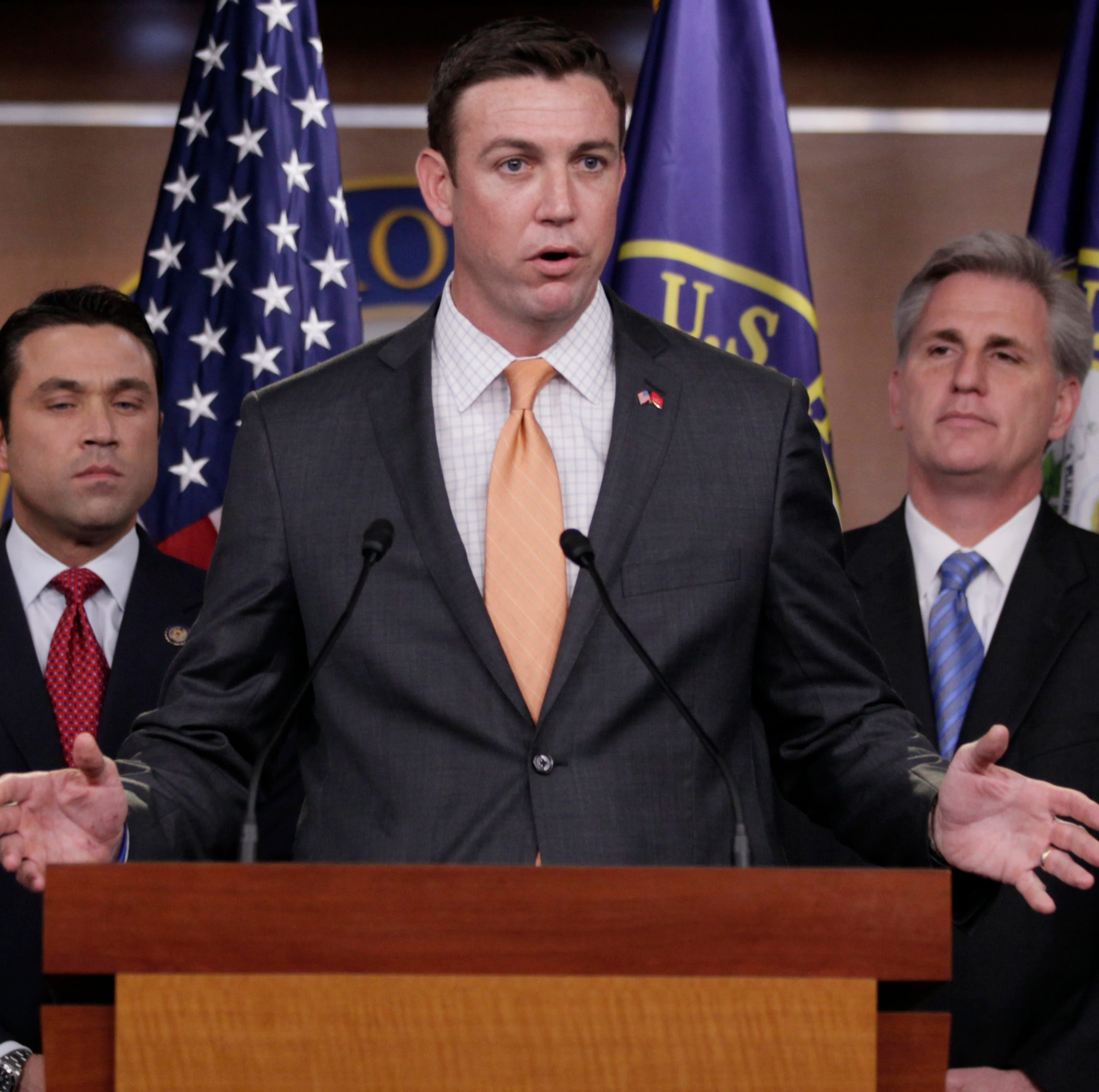 FILE - In this April 7, 2011 file photo, U.S. Rep. Duncan Hunter, R-Calif., center, speaks during a news conference on Capitol Hill.