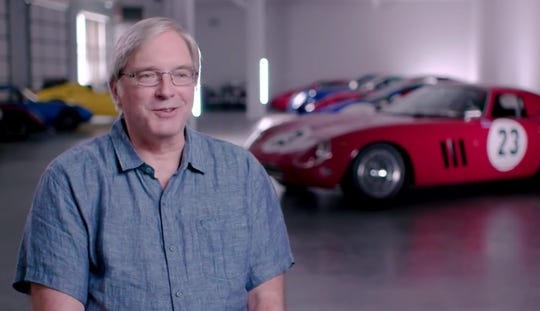 Greg Whitten was an early employee of Microsoft who used his tech stock windfall to fuel a longstanding passion for exotic vintage racing cars, including a Ferrari GTO, seen behind him. Whitten is now selling the car.