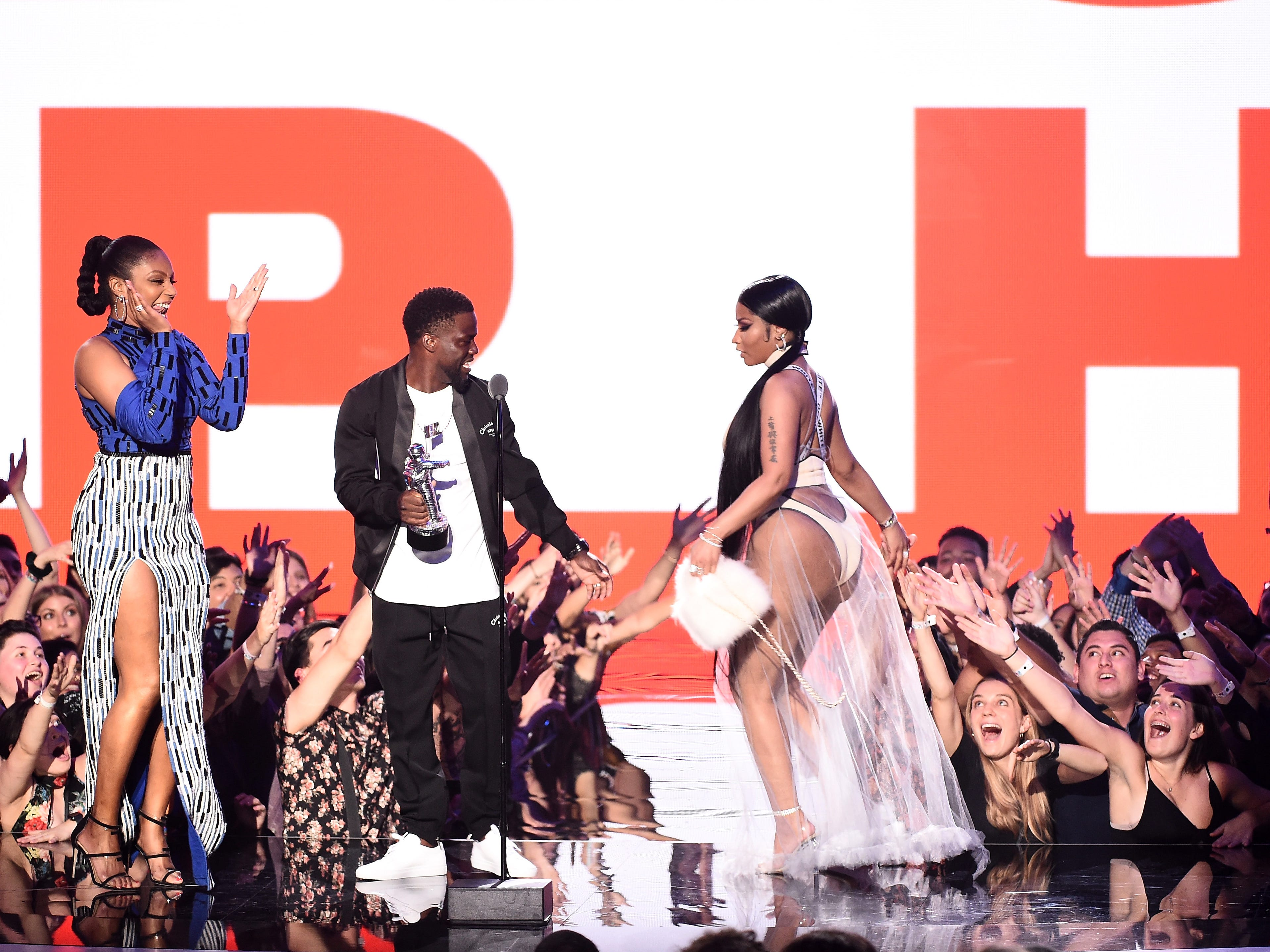 NEW YORK, NY - AUGUST 20:  Tiffany Haddish and Kevin Hart present Nicki Minaj with the award for Best Hip Hop Video onstage during the 2018 MTV Video Music Awards at Radio City Music Hall on August 20, 2018 in New York City.  (Photo by Michael Loccisano/Getty Images for MTV) ORG XMIT: 775210297 ORIG FILE ID: 1020305014