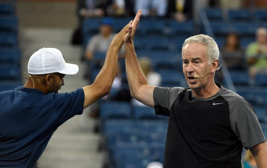 John McEnroe, right, shown here with James Blake, will be part of the ceremony to dedicate the  brand-new Louis Armstrong Stadium at the U.S. Open.