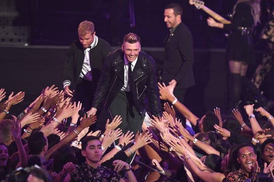 NEW YORK, NY - AUGUST 20:  Nick Carter of the Backstreet Boys greets fans onstage during the 2018 MTV Video Music Awards at Radio City Music Hall on August 20, 2018 in New York City.  (Photo by Noam Galai/WireImage) ORG XMIT: 775211585 ORIG FILE ID: 1020377518