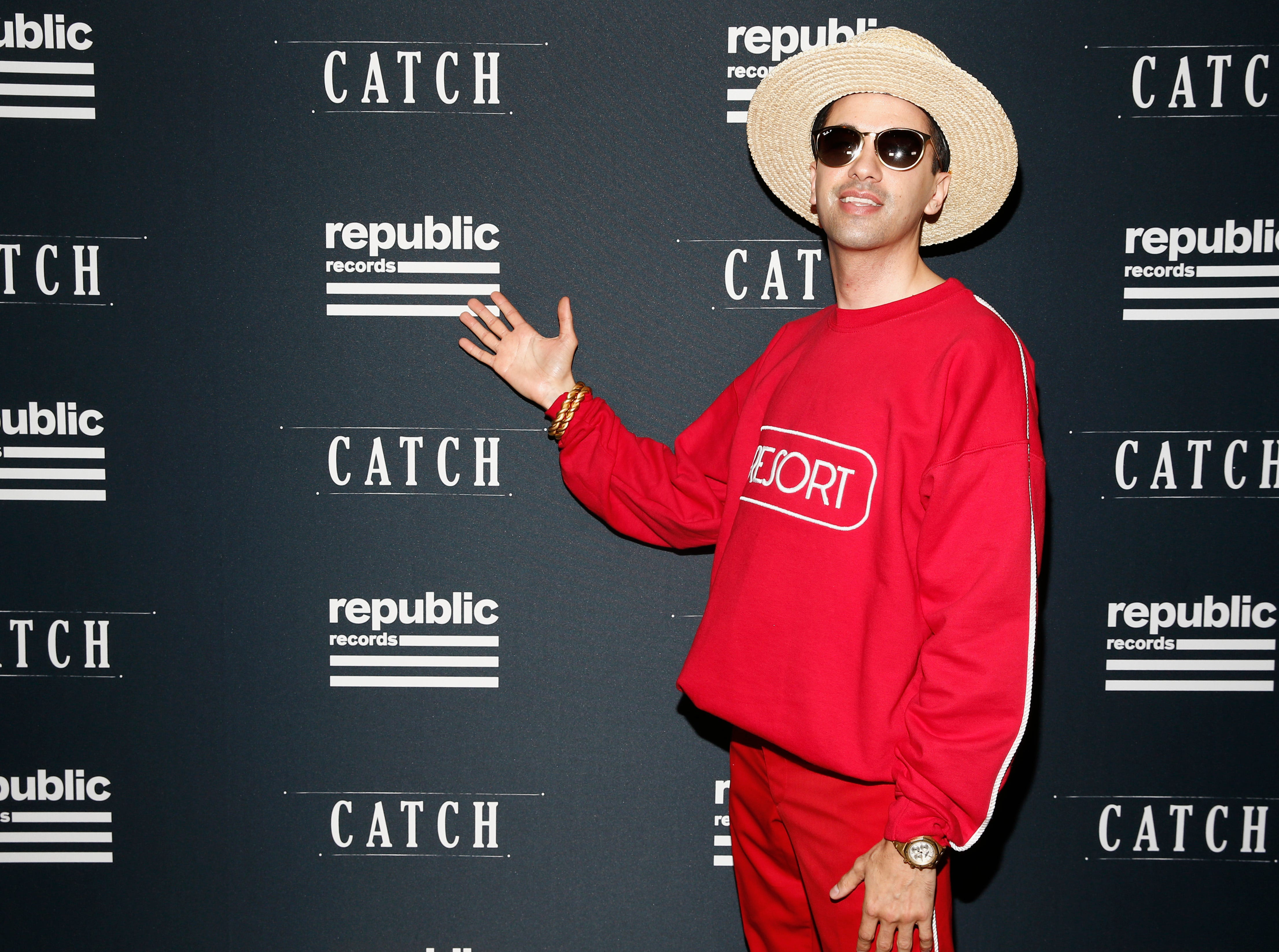 DJ Cassidy opted for a red ensemble paired with a hat and sunglasses.