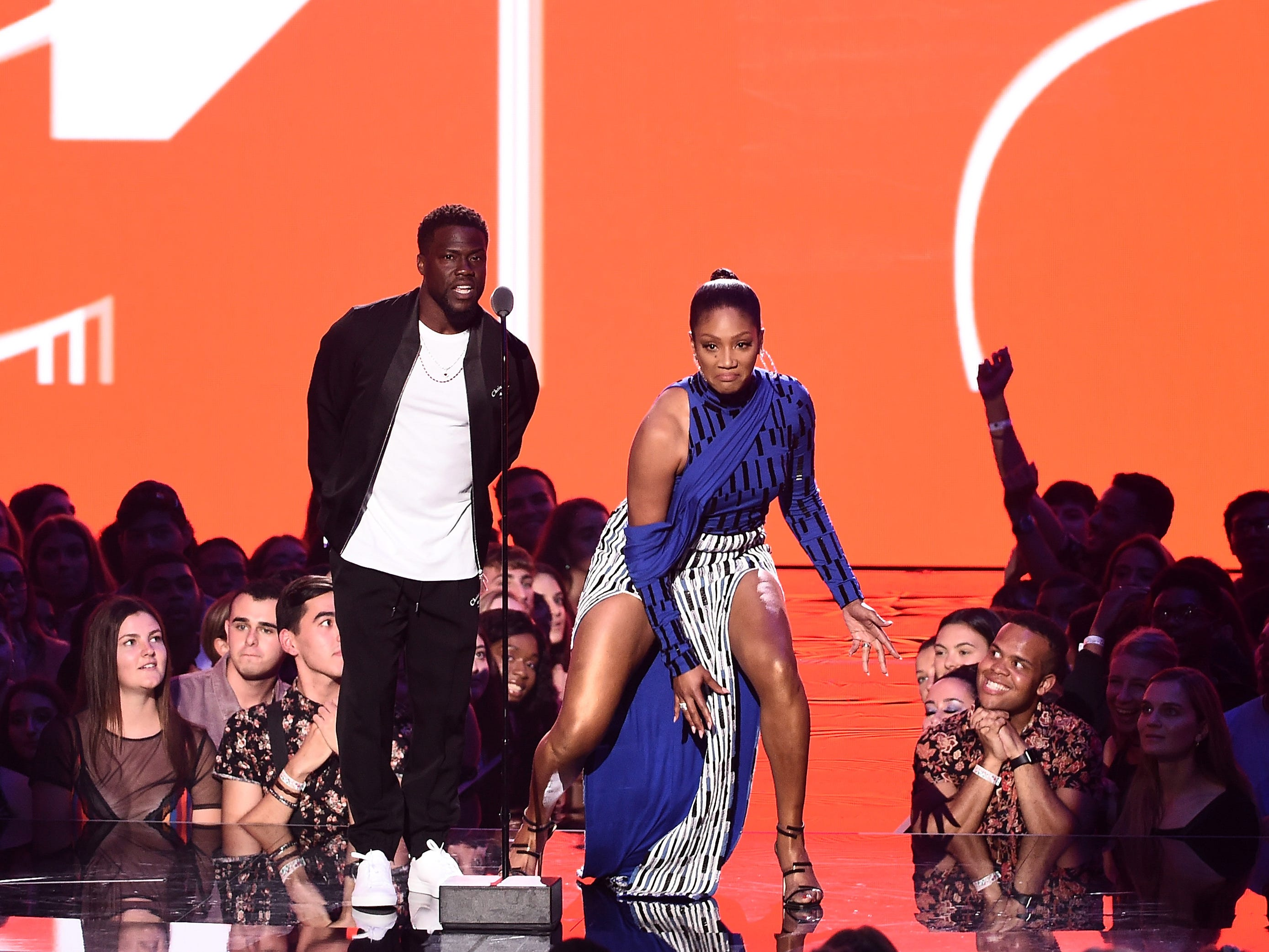 NEW YORK, NY - AUGUST 20:  Kevin Hart and Tiffany Haddish speak onstage during the 2018 MTV Video Music Awards at Radio City Music Hall on August 20, 2018 in New York City.  (Photo by Michael Loccisano/Getty Images for MTV) ORG XMIT: 775210297 ORIG FILE ID: 1020304454