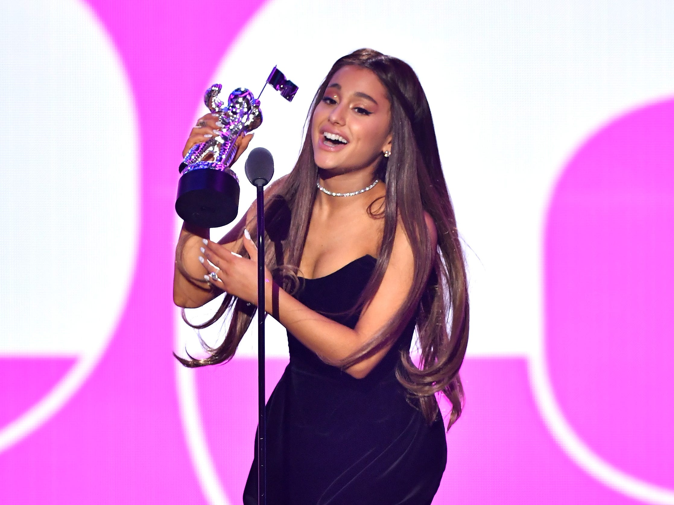 NEW YORK, NY - AUGUST 20: Ariana Grande accepts the award for Best Pop Video onstage during the 2018 MTV Video Music Awards at Radio City Music Hall on August 20, 2018 in New York City.  (Photo by Michael Loccisano/Getty Images for MTV) ORG XMIT: 775210297 ORIG FILE ID: 1020326134