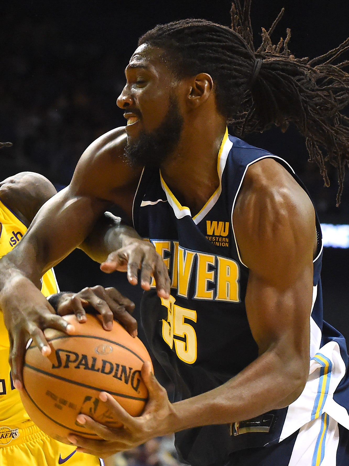 Oct 4, 2017; Ontario, CA, USA;  Denver Nuggets forward Kenneth Faried (35) and Los Angeles Lakers guard Briante Weber (12) battle for a rebound in the second half of the game at Citizens Business Bank Arena. Mandatory Credit: Jayne Kamin-Oncea-USA TODAY Sports ORG XMIT: USATSI-363500 ORIG FILE ID:  20171004_lbm_aj4_270.JPG