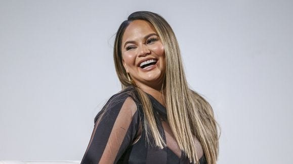 Chrissy Teigen shared a Tweet about getting sick at her daughter's school orientation.