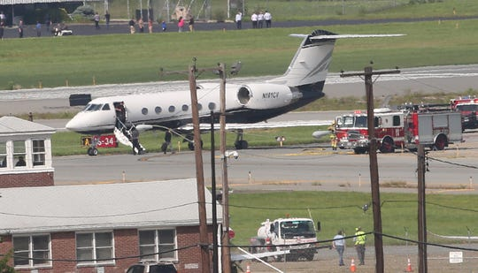 A private jet carrying rapper Post Malone landed safely at a New York airport Tuesday, Aug. 21, 2018, after two tires during takeoff.