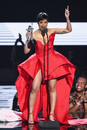 Cardi B accepts the award for best new artist onstage during the 2018 MTV Video Music Awards.