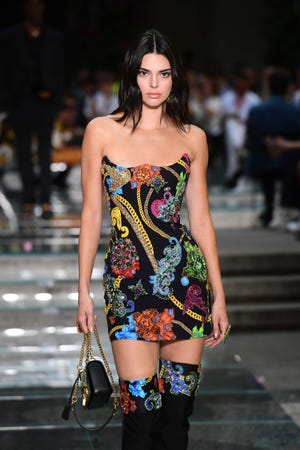 """Kendall Jenner told Love magazine she's """"super selective about what shows"""" she walks in. This Versace fashion show made the cut in Milan on June 16, 2018."""