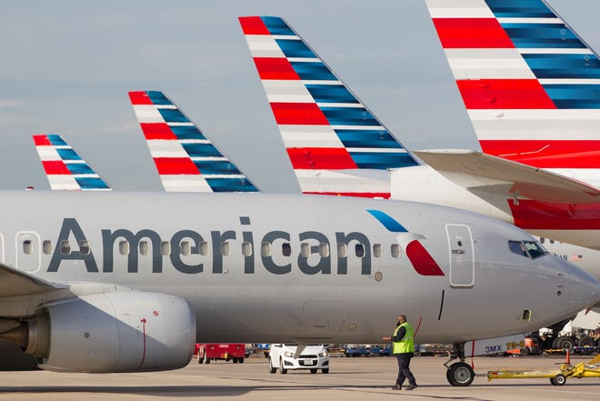 American Airlines jets ready for departure from Dallas/Fort Worth International Airport on Oct. 14, 2016.