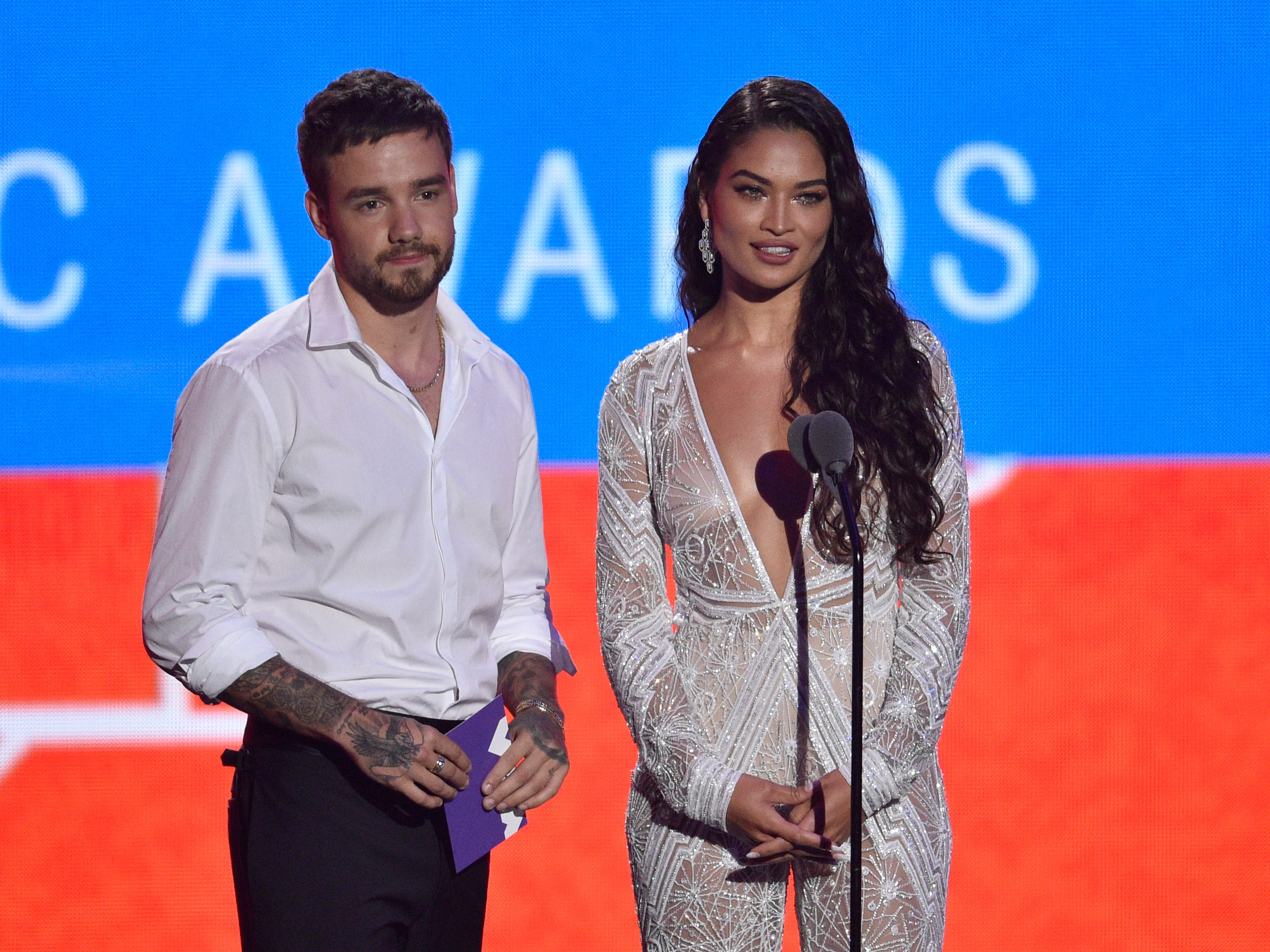 Liam Payne, left, and Shanina Shaik speak at the MTV Video Music Awards at Radio City Music Hall on Monday, Aug. 20, 2018, in New York. (Photo by Chris Pizzello/Invision/AP) ORG XMIT: CAPM264