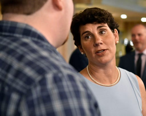 Kentucky Democratic candidate for Congress Amy McGrath, right, speaks to a supporter during the 26th annual Wendell Ford Dinner on Aug. 18, 2018, in Louisville.