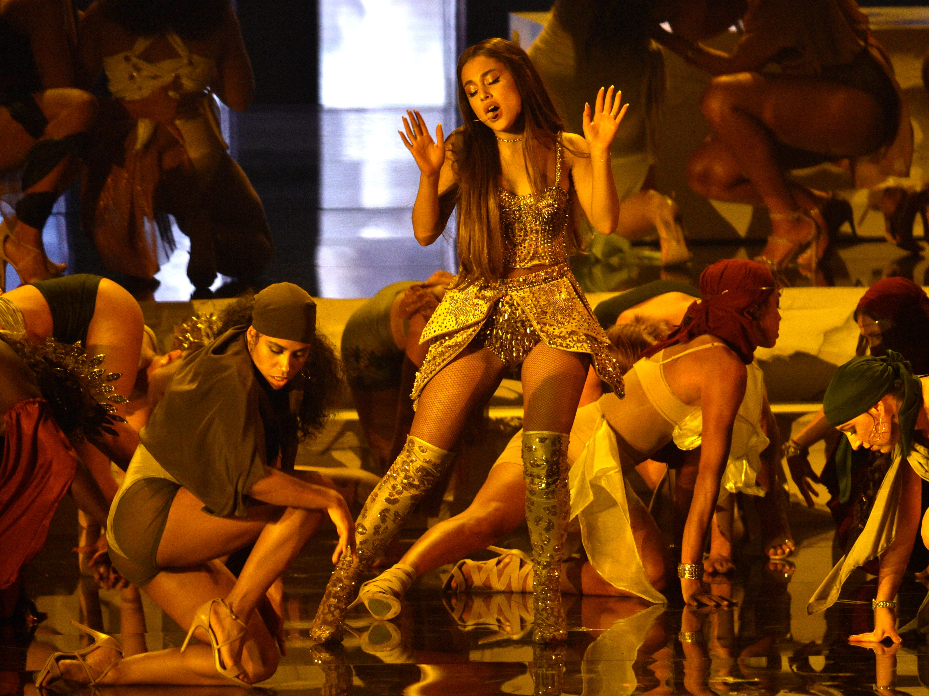 "Ariana Grande, center, performs ""God is a woman"" at the MTV Video Music Awards at Radio City Music Hall on Monday, Aug. 20, 2018, in New York. (Photo by Chris Pizzello/Invision/AP) ORG XMIT: CAPM273"